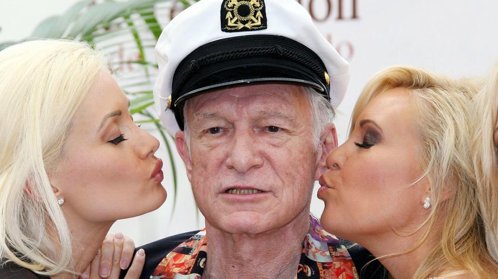 hugh hefner with two blond girls
