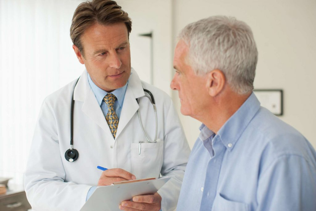 Patient talking with doctor about impotense